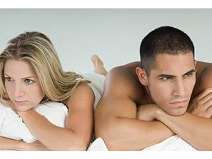 Brooding-couple-in-bed
